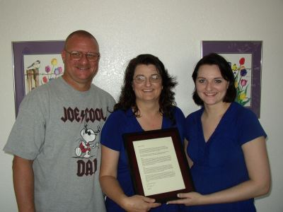 Bride & parents with their framed letter