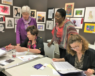 Smith helping gratitude-letter writers at workshop