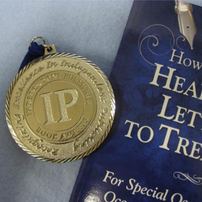 2013 Independent Publisher Book Awards medal & book