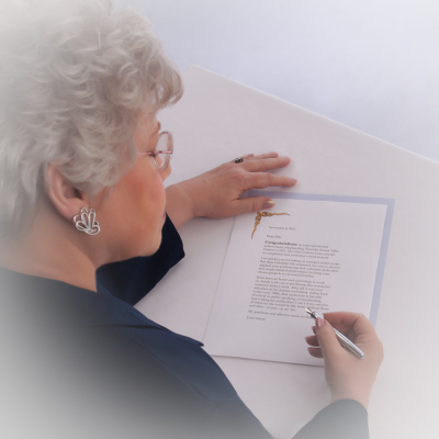 Lynette M. Smith signing a letter of appreciation